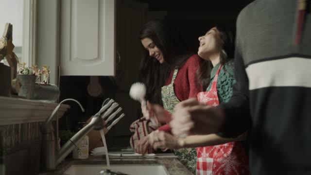 slow motion of women singing and dancing while washing dishes at kitchen sink / orem, utah, united states - sink stock videos & royalty-free footage