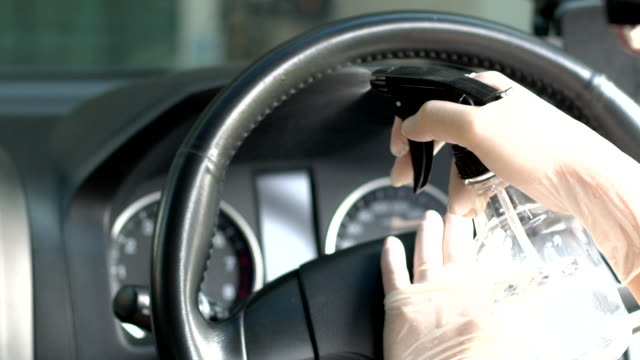 slow motion of women's hand in glove wiping down steering wheel. - glove stock videos & royalty-free footage