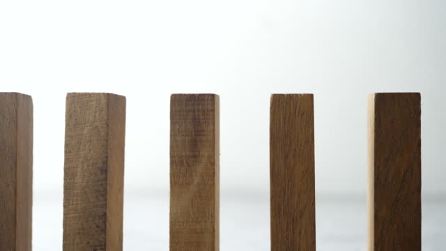 slow motion of wooden blocks falling in line - dominoes stock videos & royalty-free footage