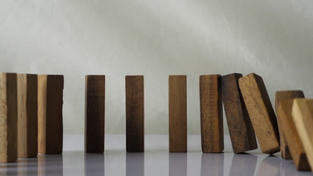 slow motion of wooden blocks falling in line - stability stock videos & royalty-free footage
