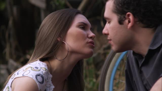 slow motion of young couple kissing. - 恋に落ちる点の映像素材/bロール