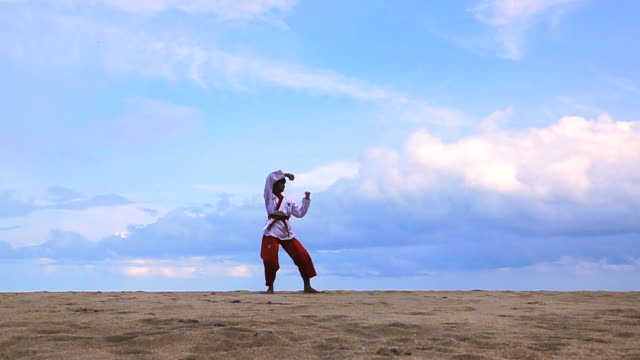 slow motion of young women practising martial arts outdoors on the beach. - self defense stock videos and b-roll footage