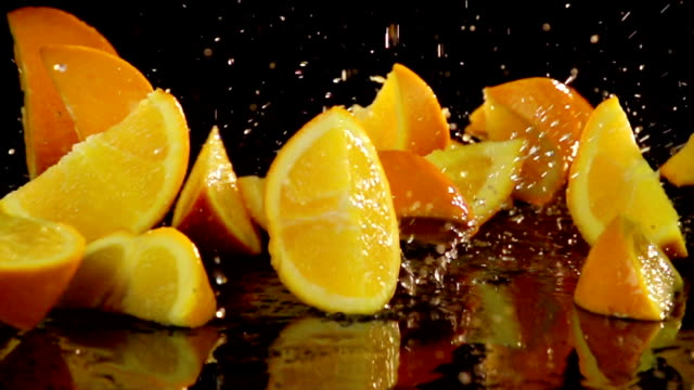 Slow Motion Orange Slices Splash