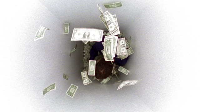 slow motion overhead wide shot dollar bills drop onto man in small white box / man smiling & jumping for joy - luck stock videos & royalty-free footage