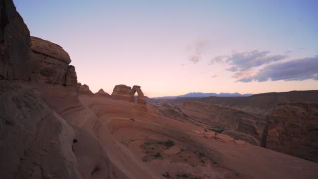slow motion pan: camera pans slowly across desert landscape - canyonlands national park, utah - canyonlands national park stock videos & royalty-free footage