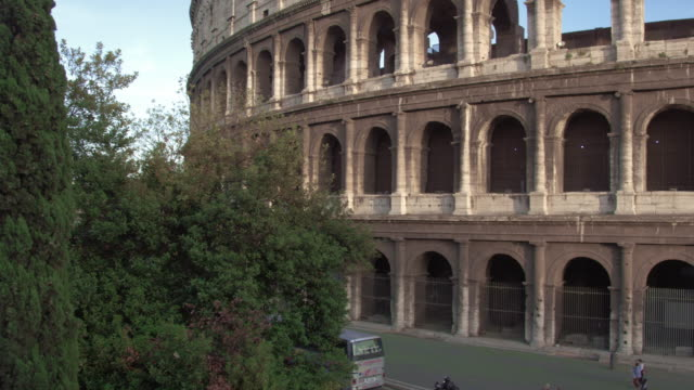 slow motion pan of colosseum to arch of constantine - arch of constantine stock videos and b-roll footage