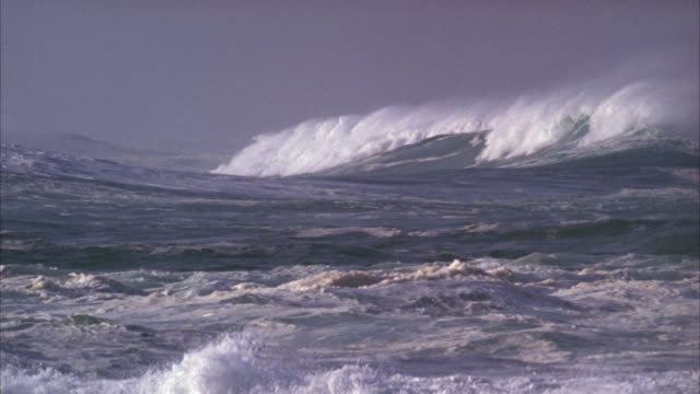 Slow motion pan of waves on a stormy sea