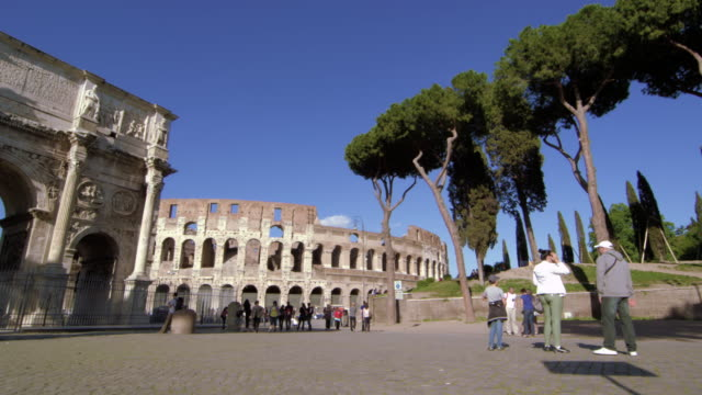 slow motion pan toward the arch of constantine and colosseum - arch of constantine stock videos and b-roll footage