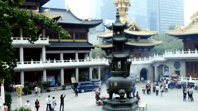 slow motion panning of a temple in shanghai... - nanjing road stock videos & royalty-free footage
