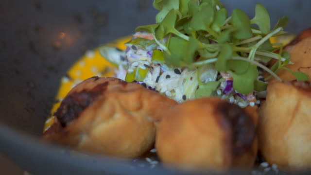 slow motion: panning past meal with garnish - garnish stock videos & royalty-free footage