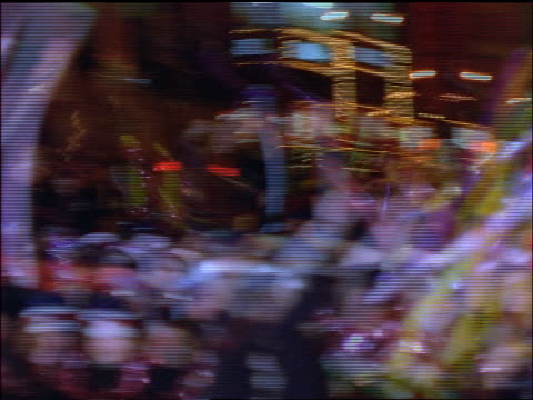 slow motion pans crowds in times square on new year's eve / new york city - 1998 stock videos and b-roll footage