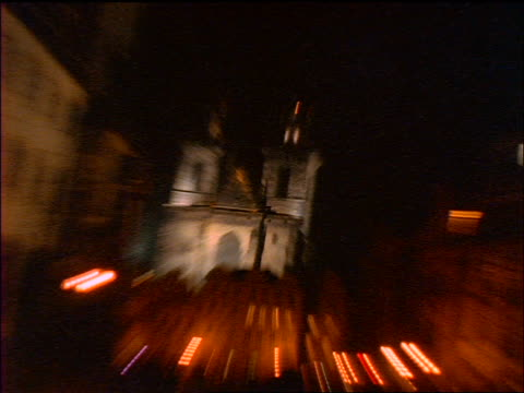 slow motion pans zoom in + zoom out old town square + tyn church at night / prague, czech republic - stare mesto stock videos and b-roll footage