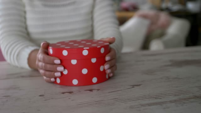 slow motion parallax shot of unrecognizable young woman holding a gift box - polka dot stock videos & royalty-free footage