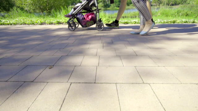 Slow motion: parents and stroller