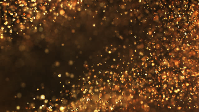 slow motion particles (dark gold) - loopable - slow-motion stock videos & royalty-free footage
