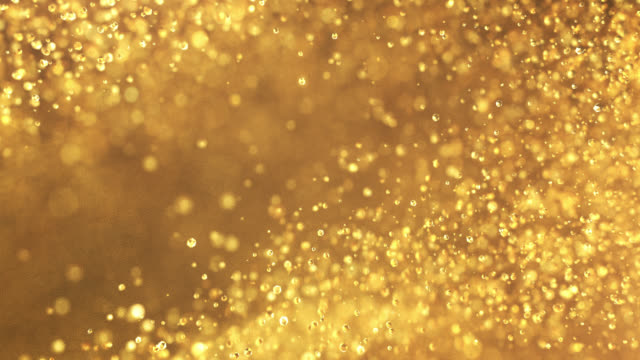 slow motion particles (gold) - loopable - gold medalist stock videos & royalty-free footage