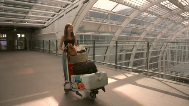 4k slow motion passengers in the airline walked to drag the luggage to the gate. in the passenger hall - suitcase stock videos & royalty-free footage