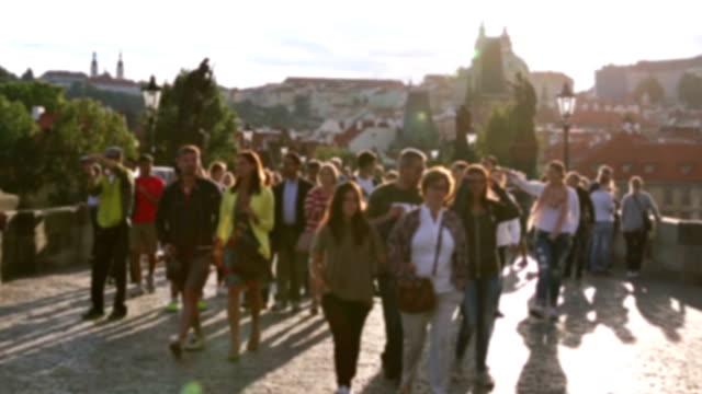slow motion: pedestrian crowded charles bridge karluv most czech republic - charles bridge stock videos & royalty-free footage
