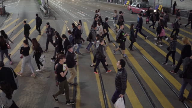 Slow motion pedestrian road crossing in Hong Kong