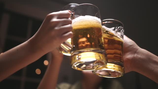 slow motion people clinking beer glasses, beer clinking - pint glass stock videos & royalty-free footage