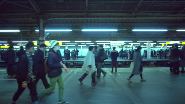 WS Slow Motion People in a busy train station in Tokyo