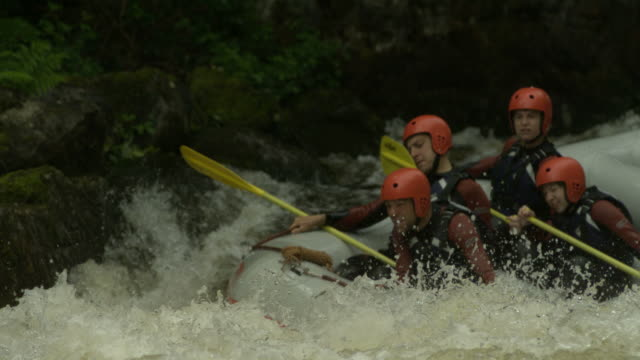 Slow motion MS people in raft going down and through rapids, UK (Individual frames may also be used as a still image. Each frame in its raw state is about 6MB or about 12MB as a 16 bit TIFF)
