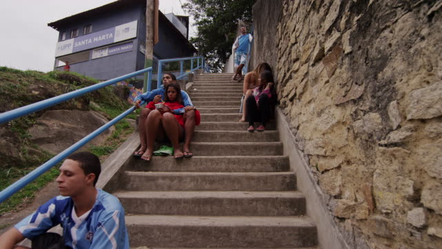 rio de janeiro, brazil - june 23: slow motion, people on stairs on june 23, 2013 in rio, brazil - favela stock videos and b-roll footage