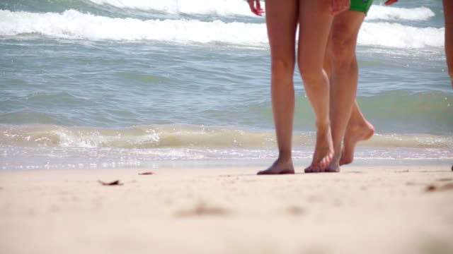 slow motion people walking on the beach - group of objects stock videos & royalty-free footage