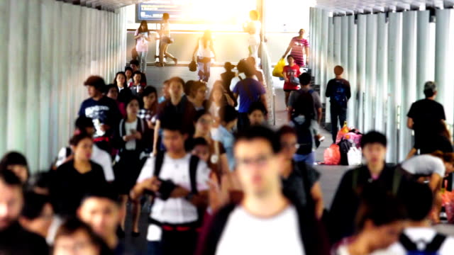 slow motion: people walking on the walkway - organisation stock videos & royalty-free footage