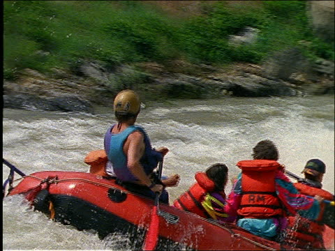 slow motion pan people white water rafting in rapids past cam - rapid stock videos and b-roll footage