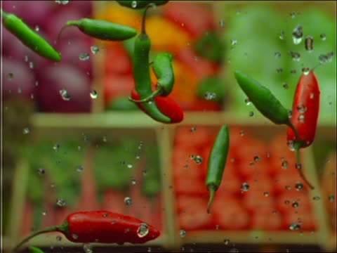 slow motion peppers + water being thrown up in air - pepper vegetable stock videos & royalty-free footage