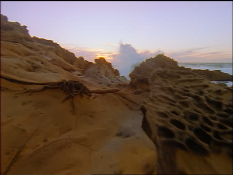 vídeos de stock, filmes e b-roll de slow motion point of view toward ocean over strange rock formations on coastline /salt point state park califiornia - pacífico norte