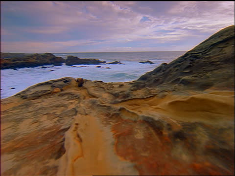 vídeos de stock, filmes e b-roll de slow motion point of view toward ocean over strange rock formations on coastline / salt point state park california - pacífico norte