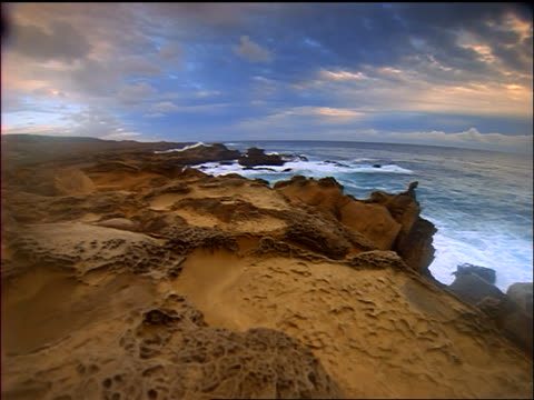 slow motion point of view toward ocean over strange rock formations near coastline / salt point state park, ca - nordpazifik stock-videos und b-roll-filmmaterial