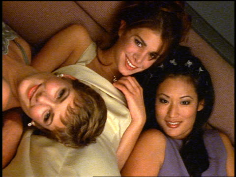 vídeos de stock, filmes e b-roll de slow motion portrait bridesmaids (1 asian) lying on seat of bowling alley snack bar - bridesmaid