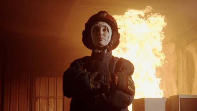 slow motion : portrait of a female firefighter - girl power stock videos & royalty-free footage