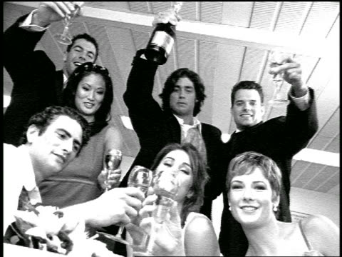 b/w slow motion portrait wedding party with champagne glasses raised in bowling alley snack bar - east asian ethnicity stock videos & royalty-free footage