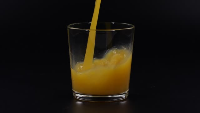 slow motion pouring orange juice - orange stock videos & royalty-free footage