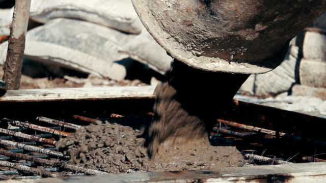 hd slow motion: pouring ready-mixed concrete after placing - tramway video stock e b–roll