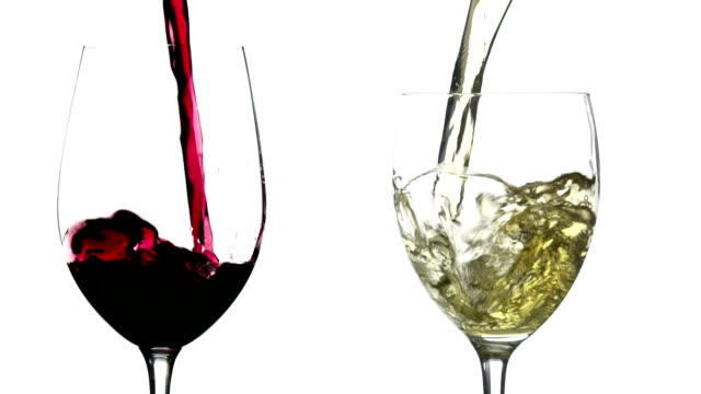 Slow motion pouring red and white wine on white background