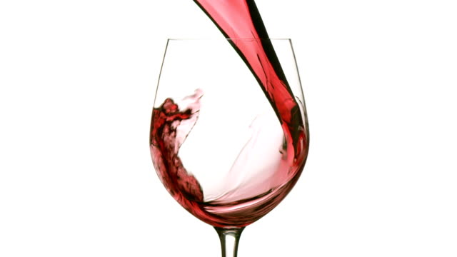 slow motion pouring red wine on white background - wine glass stock videos and b-roll footage