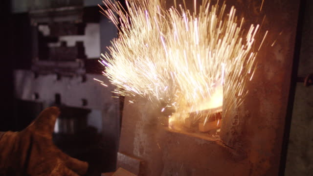 slow motion, powder thrown into forge - blacksmith stock videos & royalty-free footage