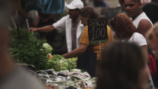 rio de janeiro, brazil - june 23: slow motion, purchasing at market on june 23, 2013 in rio, brazil - 2013 stock videos & royalty-free footage