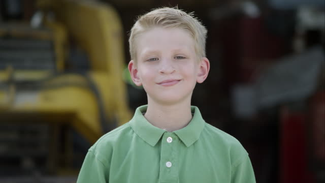 slow motion push of boy smiling with cleft lip. - blonde hair stock videos & royalty-free footage