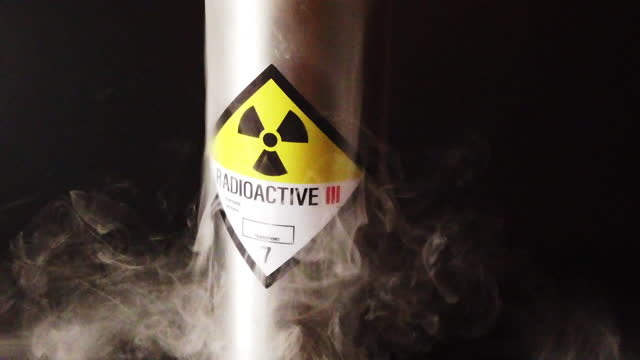 slow motion radioactive canister with smoke billowing out - weapons of mass destruction stock videos & royalty-free footage