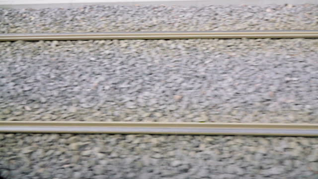 slow motion: railroad rails - pinaceae stock videos & royalty-free footage