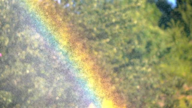 slow motion: rainbow on water sunbeams - rainbow stock videos & royalty-free footage