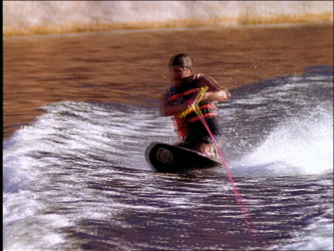 stockvideo's en b-roll-footage met slow motion rear boat point of view of man wakeboarding / wipes out - powellmeer