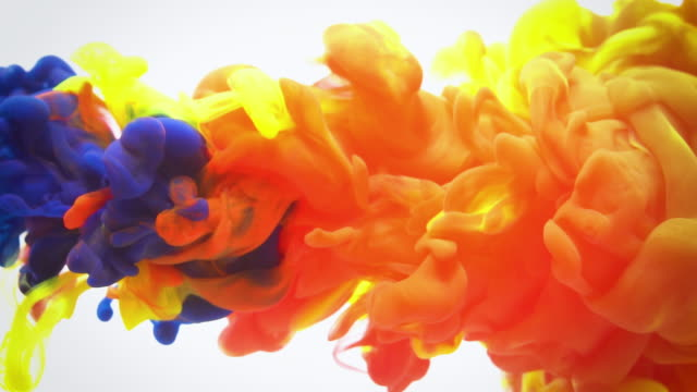 slow motion red blue and yellow ink flow in water. - mixing stock videos & royalty-free footage