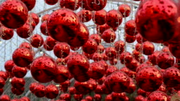 Slow motion Red Christmas decoration ball  and string light hanging at outdoor for celebration new years holiday seasonal.Holiday background.